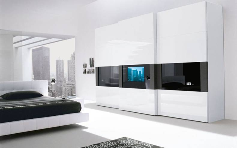 Two in one: a bedroom wardrobe plus TV-set by Presotto Italia