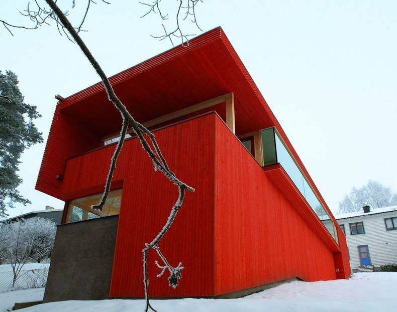 Wooden House with Red Facade by JVA Architects