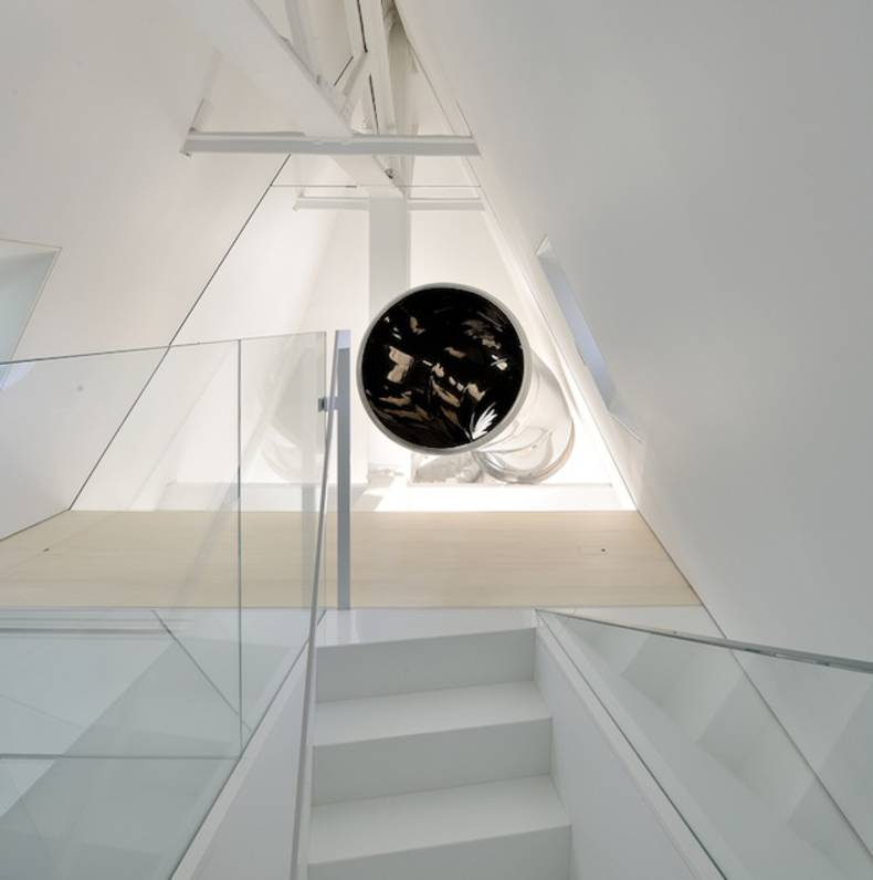Renovated Penthouse with a Slide by David Hotson